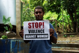 Ellison_Sau,_Project_Manager_for_the_Men_Against_Violence_Against_Women_(MAVAW)_program_at_Live_and_Learn,_holding_a_'Stop!_Violence_against_women!'_sign_(10694292115)
